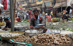 Kolkata vegetable market. Street trader sell vegetables outdoor on February 11, 2014 in Kolkata India. Only 0.81% of the Kolkata`s workforce employed in the Royalty Free Stock Photo