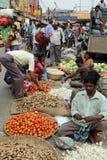 Kolkata vegetable market. Street trader sell vegetables outdoor on February 11, 2014 in Kolkata India. Only 0.81% of the Kolkata`s workforce employed in the Stock Photo