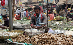 Kolkata vegetable market. Street trader sell vegetables outdoor on February 10, 2014 in Kolkata India. Only 0.81% of the Kolkata`s workforce employed in the Stock Photos