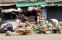Kolkata vegetable market. Street trader sell vegetables outdoor on February 12, 2014 in Kolkata India. Only 0.81% of the Kolkata`s workforce employed in the Stock Image