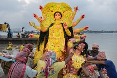 Goddess Durga idol is being immersed in holy river Ganges. KOLKATA, WEST BENGAL, INDIA - 30 SEPTEMBER 2017: Idol of Goddess Durga is being immersed in Holy stock image