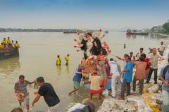 Goddess Durga idol is being immersed in holy river Ganges. KOLKATA, WEST BENGAL, INDIA - 30 SEPTEMBER 2017: Idol of Goddess Durga is being immersed in Holy royalty free stock image