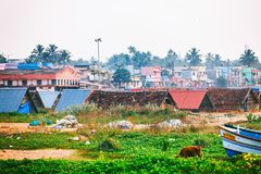 Typic street of Kollam pier marine close to Fishing boats on the beach of Kollam, India. Kollam, India - 14 February 2016: Typic street of Kollam pier marine royalty free stock image