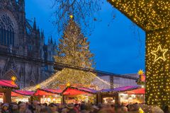 Shopping people Christmas market at square near Kolner Dom Stock Photo