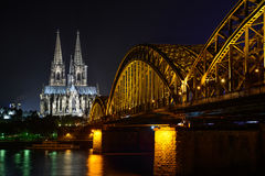 Koln by night, the skyline with the Dom church and bridge. Night view over the Rhine river on the Dom church in Koln, Germany Stock Images