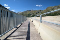 Kolnbrein Dam. Railing of Kolnbrein Dam, shadow of railing Royalty Free Stock Images