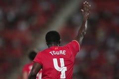 Kolo Toure of Liverpool. BANGKOK, THAILAND - JULY 14:Kolo Toure of Liverpool in action during Ture Super Trophy  Liverpool Tour 2015 at Rajamangala Stadium on Stock Photos
