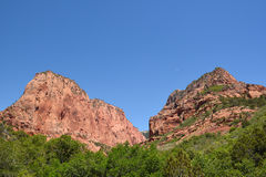 Kolob Canyons Zion. Crescent moon between hills in Kolob Canyons in Zion National Park, in the northwest corner of the park, narrow parallel box canyons are cut Royalty Free Stock Photo