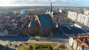 The Kolobrzeg Cathedral. Aerial view of the Co-Cathedral Basilica of the Assumption of the Blessed Virgin Mary in Kolobrzeg town, Poland stock video