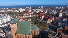 The Kolobrzeg Cathedral. Aerial view of the Co-Cathedral Basilica of the Assumption of the Blessed Virgin Mary in Kolobrzeg town, Poland stock video footage