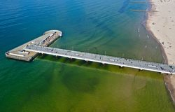 Free KOLOBRZEG, POLAND - 25 APRIL 2019 - Aerial View On Kolobrzeg City, Area Of Molo Pier At Baltic Sea Shore With Cafe Restaurant Stock Images - 146030594