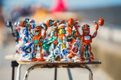 Strongman figurines made from bottle caps and sold on the promenade next to the beach by a loca Stock Photography