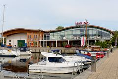 The Marina Solna building in Kolobrzeg. Kolobrzeg, Poland - June 15, 2017: The harbor building is visible at a distance and the inscription Marina Solna is royalty free stock photography