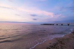 Kolobrzeg, Poland pier. Sea sunset shore landscape Royalty Free Stock Photography