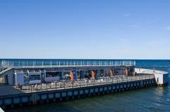 Kolobrzeg Poland, touristic landmark jetty on sunny day Royalty Free Stock Photography