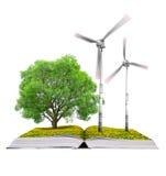 Ökologisches Buch mit Baum und Windkraftanlagen Stockbilder