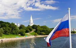 Kolomenskoe from the water with russian flag Royalty Free Stock Images