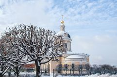 Kolomna Church of the Archangel Michael with a bell tower at dawn with beautiful clouds and Golden light of late autumn in the sno Royalty Free Stock Photography
