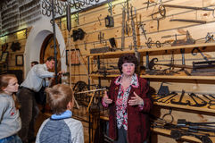Kolomna, Russia - January 03, 2017: Female-guide Blacksmith Settlement museum visitors among Stock Photos