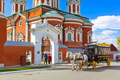 KOLOMNA, RUSSIA - MAY 03, 2014: Horse-drawn carriages (omnibus). In Kolomna Kremlin - Russia - Moscow region Royalty Free Stock Photography
