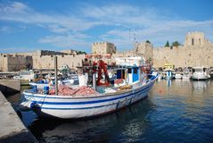 Kolona harbour, Rhodes. Boats moored in Kolona harbour in Rhodes Old Town on the Greek island of Rhodes on June 12, 2018. The Old Town is a UNESCO World Heritage stock images