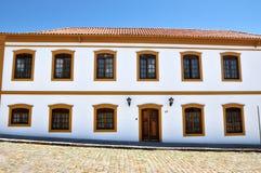 Koloniaal huis Stock Afbeeldingen