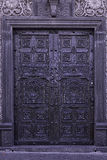 Kolonista rzeźbiący drzwi Zdjęcia Royalty Free