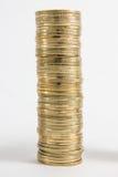 Kolonner av guld- och silvermynt på vit bakgrund Pengarbegrepp, investmentbank Arkivbild