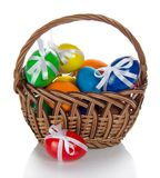 Kolorów jajka dekorujący z faborkami fotografia royalty free
