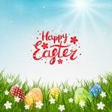 Kolorów Wielkanocni jajka na trawie royalty ilustracja