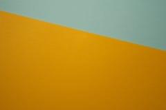 Kolor żółty i błękitny kolorowy papierowy tło Zdjęcia Stock