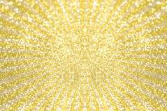 Kolor żółty i złocisty błyskotliwości bokeh na gwiazdowym wybuchu tle Obraz Stock