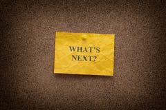 Kolor żółty miął papier notatkę z pytaniem What's następnie? fotografia stock