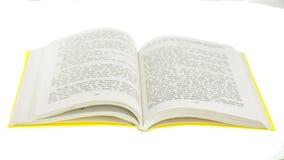Kolor żółty otwarta książka na białym tle Zdjęcia Stock