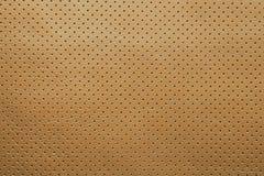 Kolor żółty tekstury dziurkowaty rzemienny tło Fotografia Royalty Free