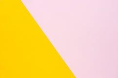 Kolor papierowy tło jest żółtym i miękkim menchią Fotografia Stock