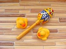 Kolorowa brzęku dziecka zabawka odizolowywająca na bambusowym tle Obrazy Royalty Free
