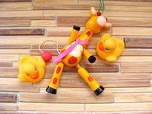 Kolorowa brzęku dziecka zabawka na bambusowym tle Zdjęcia Stock