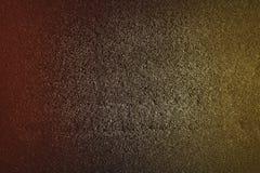 Kolorowa czerwona żółta abstrakcjonistyczna tekstura z ciemnym brzmienie błyskotliwości tłem obrazy stock