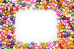 Kolorowa fałdowa papier gwiazda lub origami szczęsliwa gwiazda używać jak ramę Zdjęcie Stock