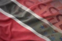 Kolorowa falowanie flaga państowowa Trinidad i Tobago na euro pieniądze banknotów tle Obrazy Royalty Free