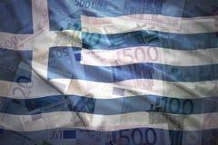 Kolorowa falowanie grka flaga na euro tle Zdjęcie Stock