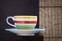Kolorowa herbaciana filiżanka Zdjęcia Royalty Free