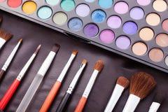 Kolorowa rama z różnorodnymi makeup produktami Obrazy Royalty Free