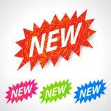 kolorowa rysująca ręka przylepiać etykietkę nowego Obraz Royalty Free