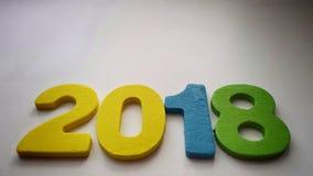 kolorowe cyfry tworzy liczbę 2018 na ciepłym białym tle Zdjęcia Stock