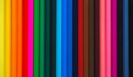 kolorowe ołówki niebieskie oczy, piaskowe abstrakcyjne tło Zdjęcia Stock