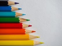 kolorowe ołówki niebieskie oczy, piaskowe abstrakcyjne tło Obraz Royalty Free