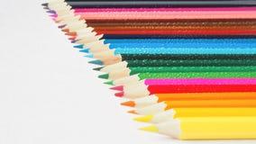 kolorowe ołówki niebieskie oczy, piaskowe abstrakcyjne tło Fotografia Royalty Free