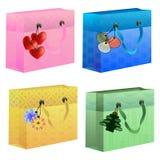Kolorowe prezent torby z thematics etykietkami Obrazy Royalty Free